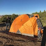 Camping in the desert in the colder months is a drier alternative.